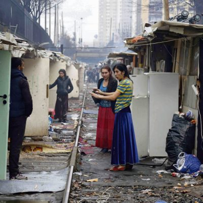 Roma people are seen in a Romani camp installed along La Petite Ceinture, an abandoned railroad line, in Paris