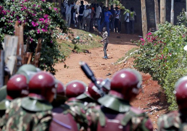 Anti-riot police attempt to disperse protesters in Kawangware slums in Nairobi
